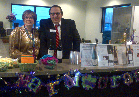 """""""Working"""" Hard: Carl Tiedemann and his daughter Elizabeth Carris poured wine at Chalet Party Shoppe's Mardi Gras Wine Tasting event in Elkhart this year."""