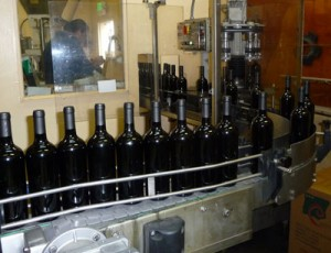 Wine made by Carl Tiedemann is being bottled in Napa Valley, California.