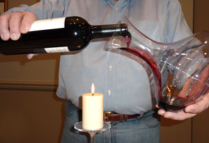 Use a candle to see into the bottle of wine to know when sediment is getting into the neck of the bottle.