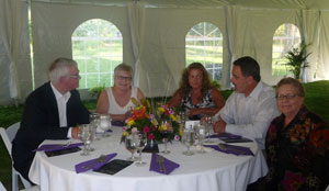 The Annual Dinner is a white-tent affair. Here Emilie Tiedemann (far right) enjoys the evening with (from left) Sam and Faye Davenport and Jan and Brad Richards.