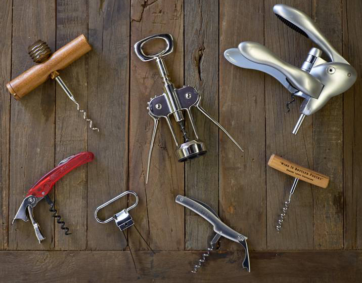 "Various types of corkscrews, pictured on the top row, from left: Basic large corkscrew, wing corkscrew and the Rabbit corkscrew. Bottom row, from left: Classic double hinged corkscrew (sommelier's knife or waiter's friend), twin prong cork puller (""Ah-So"" or butler's friend), classic single hinge corkscrew (sommelier's knife or waiter's friend) and the basic small corkscrew."