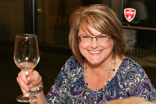 A happy wine dinner guest at Lucchese's Italian wine dinner in February 2015