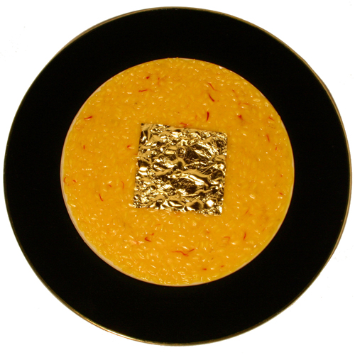 Gualtiero Marchesi's Riso, Oro e Zafferano is a creamy rice dish with his signature 14-carte gold paper square in the middle of the dish. He created the L'Oro white wine to compliment his famous dish.