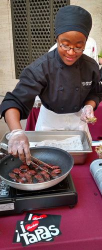 One of many tapas stations serving Morcilla (Spanish blood sausage).