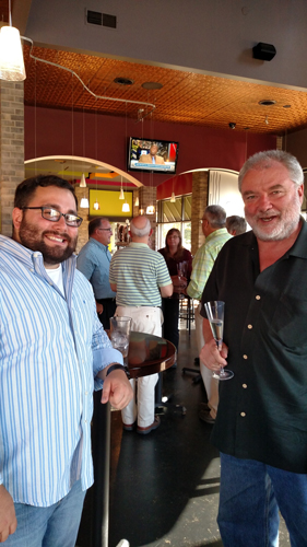 Tom Welsh, right, and his guest at the Uptown wine dinner.