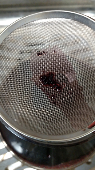 Removing sediment from wine is simple: Just decant and strain the wine before drinking.