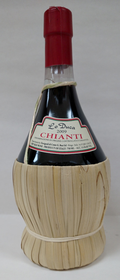 The Chianti bottle is easily spotted because of its straw basket.