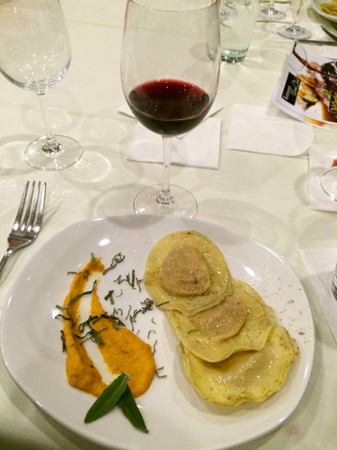 Course two: Butternut Squash Ravioli. Pureed Butternut Squash and Apple Stuffed in Handmade Ravioli. Served with Housemade Brown Butter and Sage Sauce. Paired with the 2012 Salvano Barbera Piemonte.