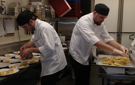 Chef Matt Hiland gets some help in the McCarthy's kitchen.