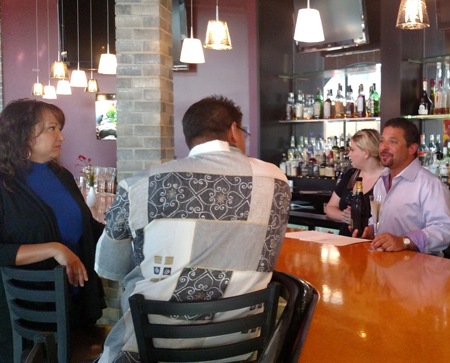 Uptown Kitchen owner Jonathan Lutz pours Prosecco for the James and Tonya Yoder of Elkhart.